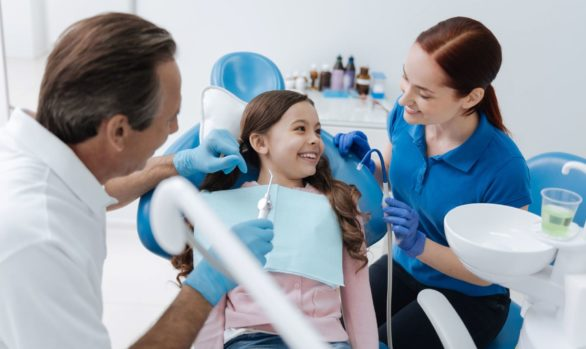 Girl and Dentist Tooth Cleaning