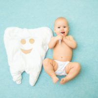 Brushing teeth of a young baby